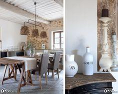 Table en bois sur tréteaux, chaises et fauteuil 'Flamant', suspension chinée équipée d'abat-jours 'Athezza', pichet à vin et bouteille à goutte de la 'Faïencerie de Charolles'