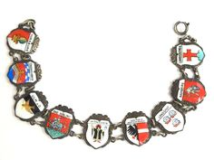 Vintage Germany Enamel Shield Charm Bracelet – Germany Shield – Charm Bracelet https://etsy.me/2qP31rj #jewelry #bracelet #silver #traveltransportation #springring #charmbracelet #germancharm #germanshieldcharm #germany