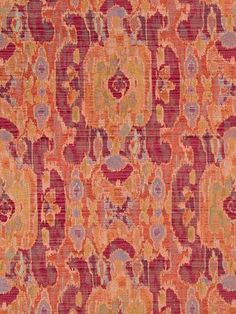 Upholstery fabric in a traditional design of coral orange, dark fuchsia and lavender.