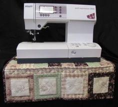 Add this useful and attractive sewing machine mat to your sewing room! The mat protects your table and provides pockets for sewing accessories. The design combines embroidered squares with simple patchwork and quilting. Pattern available at www.magicpatchquilting.com