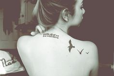 """""""Inside all of us is a wild thing"""" back tattoo."""