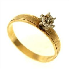 1.8 Gram 14kt Two-Tone Gold Ring With Diamond Accent  http://www.propertyroom.com/l/18-gram-14kt-twotone-gold-ring-with-diamond-accent/9445535