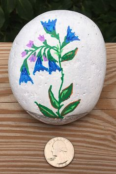 This Blue Flower Hand Painted Rock will make a one of a kind decorative housewarming gift for that special friend, deserving teacher, gardener who has everything, or yourself. If you like what you see in the pictures and video, you'll be pleasantly surprised when you receive the rock and see it person. Painted Rocks For Sale, Hand Painted Rocks, Blue Bell Flowers, River Stones, The Rock, Gift For Lover, Picture Video, Etsy Store, House Warming
