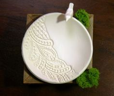 Lace bowl. Sculpty clay, press lace into it, cut into circle, place in oven safe bowl, follow baking instructions. Paint?