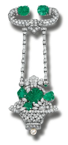 EMERALD AND DIAMOND LAPEL WATCH, TIFFANY & CO,  CIRCA 1920.  The brooch suspending a floral braided basket, millegrain-set with circular-, single-cut, marquise-shaped and baguette diamonds, accented with carved emerald leafs, the reverse set with a rectangular dial applied with black Roman numerals, on a seed pearl crown, dial signed Tiffany & Co.