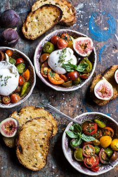 Brilliant-looking tomato salad accompanied with hunks of gorgeous-looking cheese and artisanal bread. Great shot. Love the halved figs.