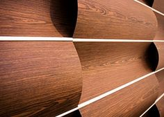 Wave Wall:  modular horizontal or vertical wall system made from wood; can be lit from behind or front and above; Wovin Wall, Mascot NSW, Australia