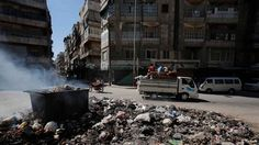 Smoke clears up after residents burn rubbish at the center of Aleppo city, August 23, 2012. REUTERS/Youssef Boudlal. #SYRIA