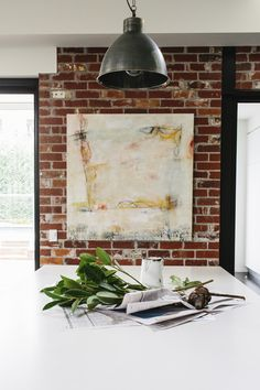 Amazing Industrial And Ethnic Loft Of An Old Warehouse : Ethnic Loft Of An Old Warehouse With Brick Wall And White Wooden Table And Chandeli...