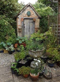I like the weathered door and old brickwork on this garden shed - you could probably do the same by buying reclaimed bricks and doors. Garden Deco, Garden Pots, Garden Sheds, Potted Garden, Brick Garden, Potted Plants, Brick Shed, Edible Plants, Herb Garden