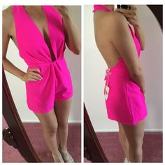 HOT! Pink halter romper This outfit is sure to stand out. Perfect for clubbing in Vegas! This is HOT pink, super bright. Very sexy open front and open back would look AMAZING with a tan!! Brand new with tags never worn. Dresses Backless