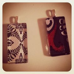 custom glass pendants:  glass shape, cute paper design or collage (heavy paper works best), craft sealant, jewelry bail & expoxy-type glue.  These were made @ A Work of Heart studio in Willow Glen, CA. www.aworkofheart.com