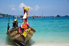 Longtail boat by h0lydevil, via Flickr