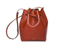 Mansur Gavriel - Bucket Bag in brandy, also available in black (http://mansurgavriel.com/bucket-bag-black/) or cammello (http://mansurgavriel.com/bucket-bag-cammello/), $460