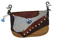 DESERT SAND CONCEALED CARRY - tan cowhide bag features contrasting browns & cream. Real ostrich & cream-colored laser hair-on-hide w/crystal studs surround clear beveled centerpiece. Fits a .22 caliber, .38 special or small semi-automatic gun. Back zipper pocket is lined to keep leather filings from getting to the gun & Velcro attachment secures gun butt in back zipper pocket. Wear on either side to provide for a back draw or cross draw access. Clip on belt loop or use included strap.