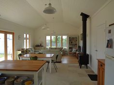 tasmanian-cottage-3 880sf open, airy, filled with light, large bedroom, space to set up studio when desired