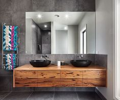 The grey tiles and black stone basins compliment this timber vanity beautifully. The simplicity of this bathroom allows the stunning timber vanity to be the hero of this space. Timber Bathroom Vanities, Timber Vanity, Wooden Vanity, Bathroom Basin, Laundry In Bathroom, Grey Bathrooms, Ensuite Bathrooms, Bathroom Renos, Beautiful Bathrooms