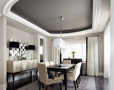 Simple use of sideboard, lighting and mirror and rug warm and complete the dining space.