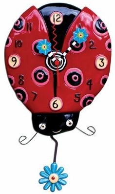 "Allen Designs Ladybug Pendulum Clock by Close2MyArt. $55.00. hand painted on resin. pendulum flower is blue on one side/green on the other. measures 6.25""x11"". hand-painted flower clock hands. ©2010 Allen Designs, designed by artist Michelle Allen. Cute as a bug! Fly this lovely little ladybug into your home!! This whimsical clock's mechanism warranted for two years and requires a ""AA"" battery"