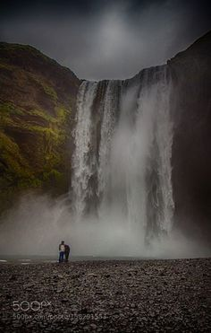 Two people and Skogafoss