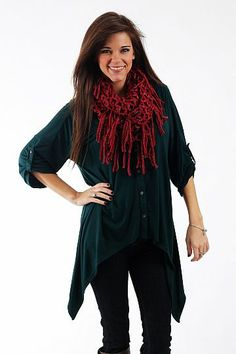 """Easy For You Top, Hunter Grn $38.00  This top is super comfy! This piece has an amazing asymmetrical neckline, buttons up the front, tabbed sleeves and a v neck. But our favorite part is the incredibly soft and cozy material! Put this on with jeans and boots for a chic look that'll be comfy all day long.   Fits true to size. Miranda is wearing a small.   From shoulder to hem:  Small - 26""""  Medium - 27""""  Large - 28"""""""