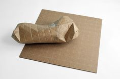 Designed by Patrick Sung, the packaging design concept features triangulated perforations that allow it to bend around odd forms. Read more: Ingenious Cardboard Packaging Folds to Fit Parcels of Any Shape