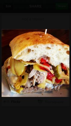The Spaniard. Slow roasted pulled pork, artichokes, red peppers, stuffed olives, and mozzarella.