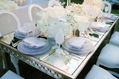 Elegant touches of frosted glass and beautiful rose and orchid arrangements tie together this Elsa inspired wedding.