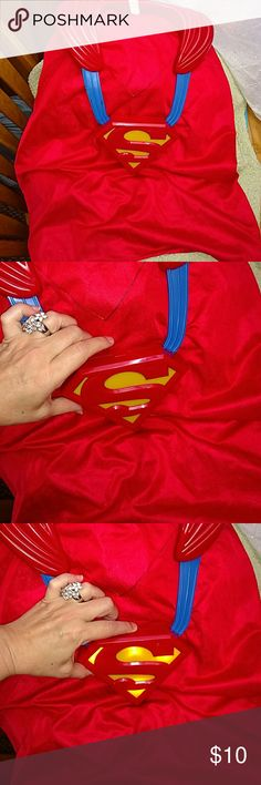 Super awesome Superman Cape by DC Comics Large size Superman Cape for toddlers, my son was about 3 to 6 years old...he is outgrowing it needs a new home. This is not a light cape due to the fact of the center battery housing which lights up. You can see lit up on the third picture. Please watch your child with this cape because it does go over the head/ neck area and I would never want an accident to occur...just want to say that because its a cape nonetheless. Ask me questions make an offer…