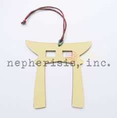 Hermes Petit H Torii (Shrine gate) leather ornament. Large size. New condition with Hermes box & ribbon.