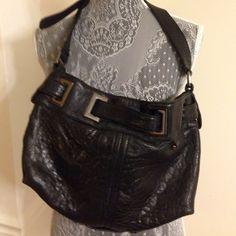 Shoulder bag Kenneth Cole leather bag,lightly used,excellent condition.black metal accents. Kenneth Cole Bags Shoulder Bags