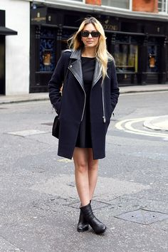 Coggles Fashion - London Street Style with oversized black sunglasses, navy blue coat with contrast black leather sleeves and collar, black shift dress and black boots.     #streetsyle #womenswear #fashion