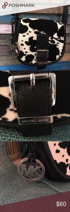 Cowhide MK purse Small MK cowhide bag. Good condition. Show a little wear inside. Shoulder strap. Michael Kors Bags Mini Bags