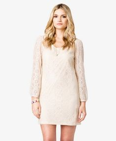 A lace shift dress with a scoop neckline, button cuffs, and long sleeves. Semi-sheer. Partially lined. Knit. Medium weight.
