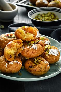 Balushahi aka Badusha is a delicious deep fried flaky traditional Indian sweet that is made from flour mixture( with ghee and yogurt) and dipped in sugar syrup to glaze it. Indian Dessert Recipes, Indian Sweets, Indian Snacks, Eid Sweet Recipes, Asian Recipes, Köstliche Desserts, Delicious Desserts, Yummy Food, Delicious Cookies