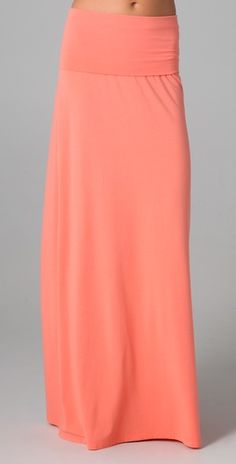 Lovely peach maxi skirt for spring. I would pair it with a slouchy, pale yellow tank (tucked in), tan gladiator sandals, and a dainty gold necklace.