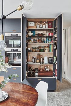 dark grey laminate plywood kitchen Kitchen Larder, Kitchen Pantry Storage, Pantry Design, Kitchen Design, Kitchen Ideas, Pantry Ideas, One Bedroom Flat, Diy Bedroom, Modern Kitchen Furniture