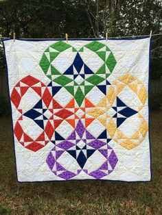 """From: Tracy Wagner """"A wedding quilt that I just finished for my dear friends who are getting married in Feb. I hand pieced and hand quilted it. I named it """"You Can..."""" and the design includes a blue eternity circle and rainbow hearts. The Storm at Sea template can be found on http://quiltinspiration.blogspot.com/"""""""