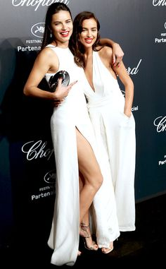 Hot, hot! The supermodels heat up the Chopard party in coordinating white ensembles, with Irina in a Misha Nonoo jumpsuit.