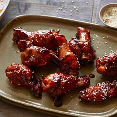 Rinse chicken wings and pat dry. Remove tip and discard; separate each wing at the joint into 2 pieces. Place wings in a shallow dish ...
