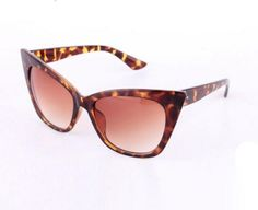 """Sexy """"Cat Eye"""" Sunglasses in Leopard color."""