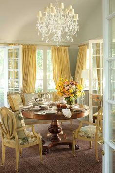 The Enchanted Home. like the white shade and golden yellow drapes.....