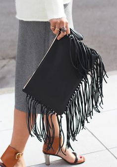Doing somethingas easyas adding fringe to a simple leather clutch will makeyou wonder how one could live with a such a boring frill-less pouch to begin with. I dare you to do this tutorial and resist the urge to give another accessory the fringe treatment. Because honestly, everything is