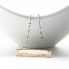 Personalized nameplate necklace hand stamped by Classy Mama Designs.