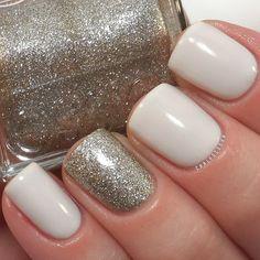 Nail Design. Nail art. Creative. Nails. Polish. Happy New Year Nail Art. Luxury. Essie. Glitter, white.  Instagram photo by @Carly Sisoka
