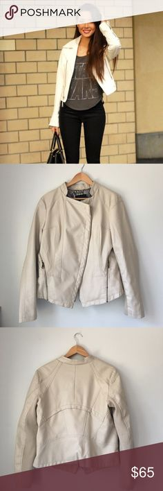 Steve Madden Moto Jacket Light Beige/cream faux leather Moto jacket by Steve Madden. Underside of arms is made of knit fabric. Brass tone hardware. Fully lined. Shell face: 100% polyester. Shell backing: 60% viscose 40% polyester. Knit: 100% acrylic. lining: 100% polyester. (Model is wearing slightly different style). Size Large. EUC. Steve Madden Jackets & Coats Utility Jackets