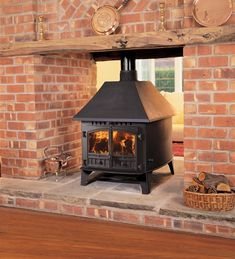 Hunter Stoves 'Herald double-sided, single-depth wood burning stove is a view as beautiful as an English sunset - and infinitely more interesting than a white radiator. If you've got a big room to heat, a wood burning stove is the romantic choice. Fireplace Garden, Farmhouse Fireplace, Faux Fireplace, Double Sided Fireplace, Fireplace, Farmhouse Homes, Wood Burning Stove, Tall Fireplace, Wood Stove