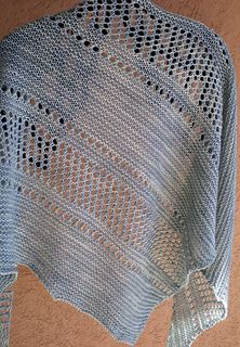 Simple & chic one skein wonder with bias construction, garter stitch and eyelets.