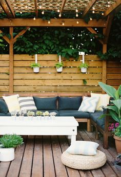 cozy outdoor sofa under a pergola