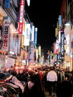 Myong dong.  Younger, hip shopping area with lots of restos.